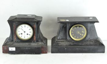 A slate mantel clock with red marble insert together with another similar