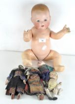 An early 20th century Armand Marseille doll, 351/6K, together with various other dolls