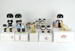 A collection of assorted Wade ceramic figures and wares, various designs and models,