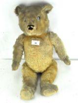A 20th century mohair teddy bear, with articulated limbs,