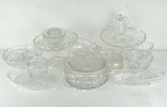 A large selection of glassware, comprising mostly press moulded glassware, including jelly moulds,