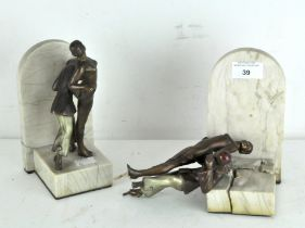 A pair of Art Deco Spelter bookends, depicting dancing couples in period dress, on marble bases,