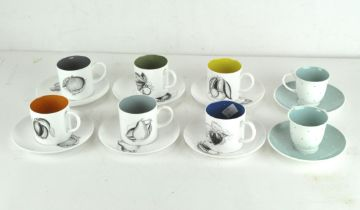 A vintage Suzie Cooper coffee service comprising six cups and saucers decorated with fruits,