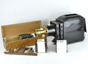 An early 20th century Optimus Magic lantern, black painted case with brass detailing, 45cm long,