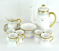 A six piece Shelley coffee set, decorated with gilt Greek key pattern border over a shell motif,