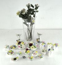A collection of decorative floral posy vases,