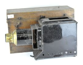 An early 20th century Magic lantern projector, black painted with brass detailing,
