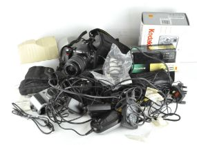 A Nikon D40 digital SLR camera together with various other cameras and related equipment