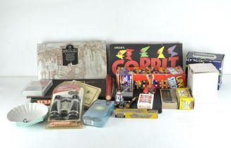 A collection of assorted vintage games, including Scrabble, Draughts,
