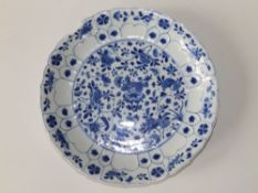 A Chinese Kangxi blue & white porcelain dish, having fluted rim, the central panel decorated overall
