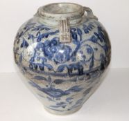 A 16thC Vietnamese blue & white jar, the short neck with four small loop handles onto round