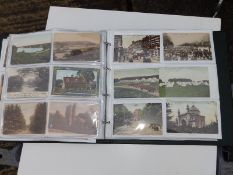 A plastic folder containing approximately 120 early 20thC postcards depicting English town views.