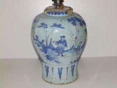 An 18thC delft blue & white vase, of octagonal inverted baluster shape, painted with chinoiserie