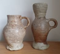 """A 15thC pottery tankard, 6"""" high together with a restored example. (2)"""
