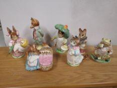 Five Beswick Beatrix Potter figures with gold backstamps; Mrs Rabbit, Tailor of Gloucester, Hunca