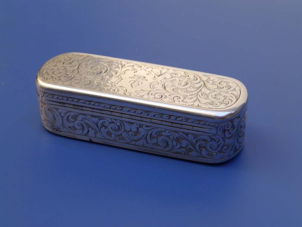 A Victorian crested silver snuff box with overall arabesque leaf scroll engraved decoration, gilt