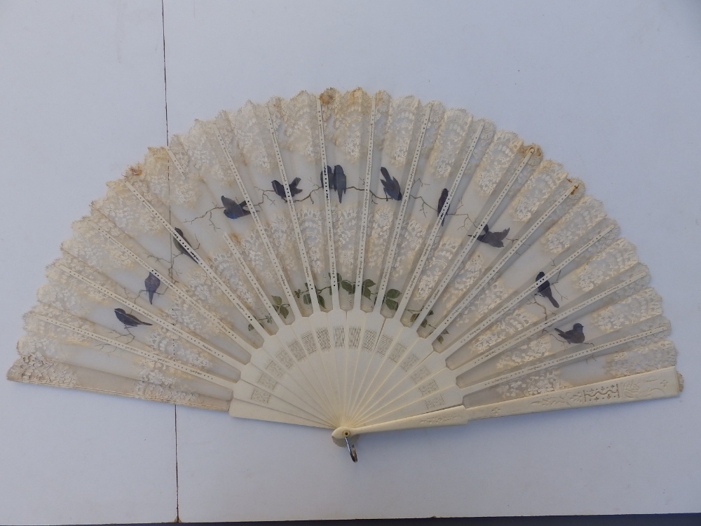 """A large 19thC bone fan, the silk leaf decorated with lace and painted birds, 26"""" across - one - Image 4 of 6"""