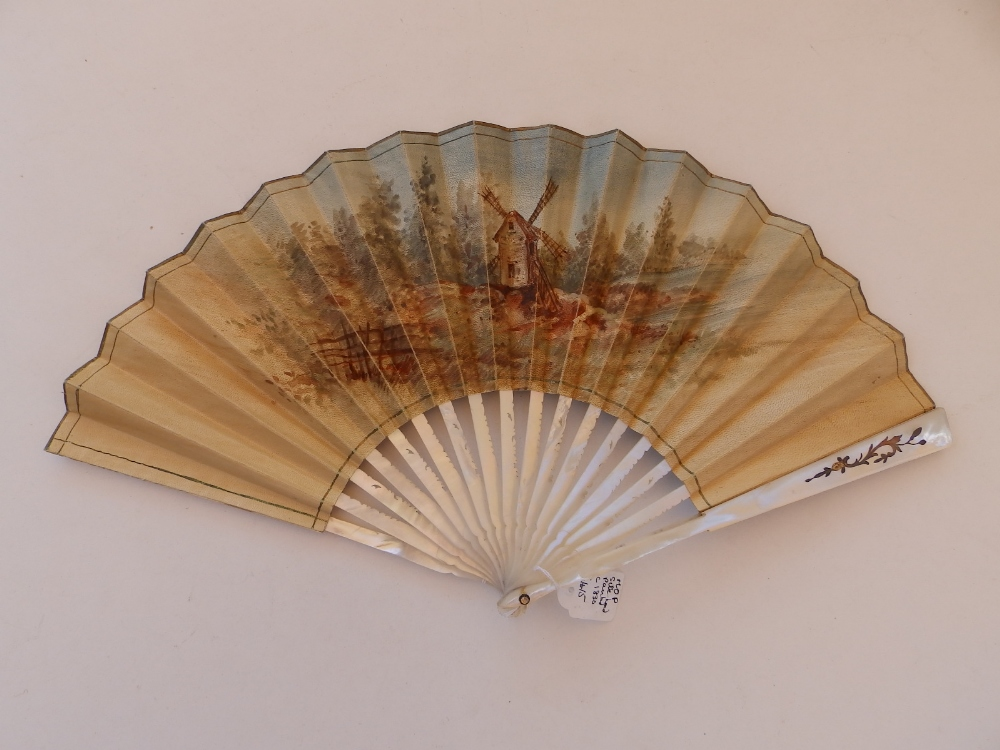 An early 19thC mother-of-pearl fan, the paper leaf painted with a young dancing couple to one - Image 2 of 3