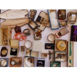 A tin containing a large quantity of costume jewellery & watches.