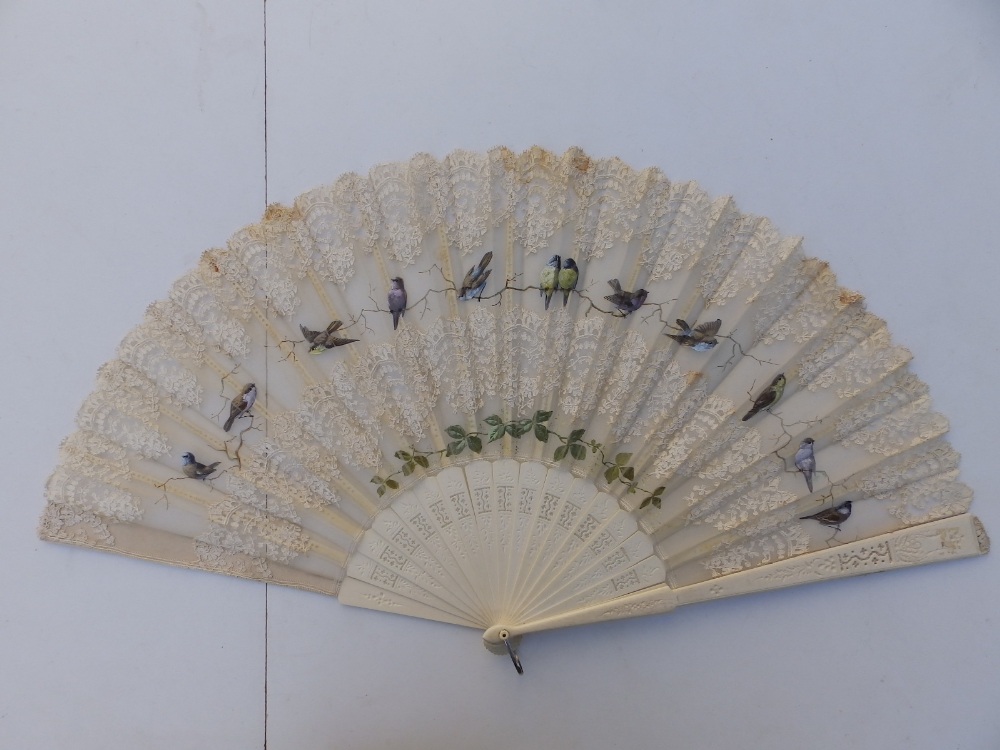 """A large 19thC bone fan, the silk leaf decorated with lace and painted birds, 26"""" across - one - Image 5 of 6"""