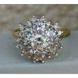 A modern diamond cluster ring on 18ct gold shank - London marks. Finger size S.