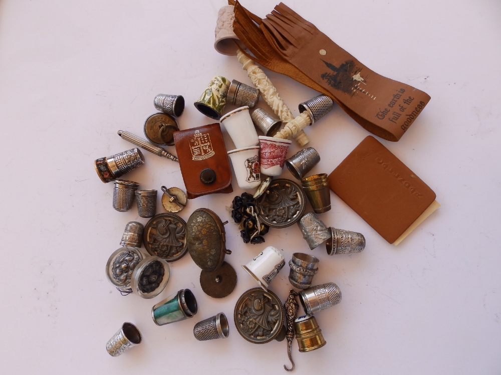 Thimbles, buttons and other sewing accessories.