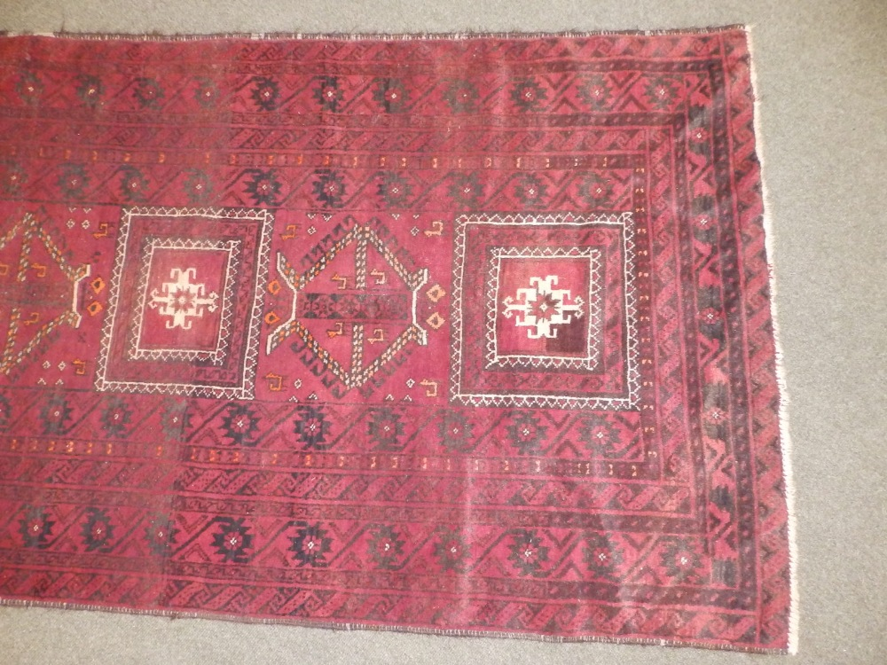 A Baluchi rug, the centre occupied by three rectangles and two octagons with small animal motifs, - Image 2 of 6
