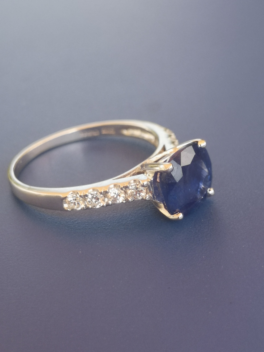 A modern sapphire solitaire ring, in four claw setting with small diamonds to shoulders, 14ct - Image 2 of 3