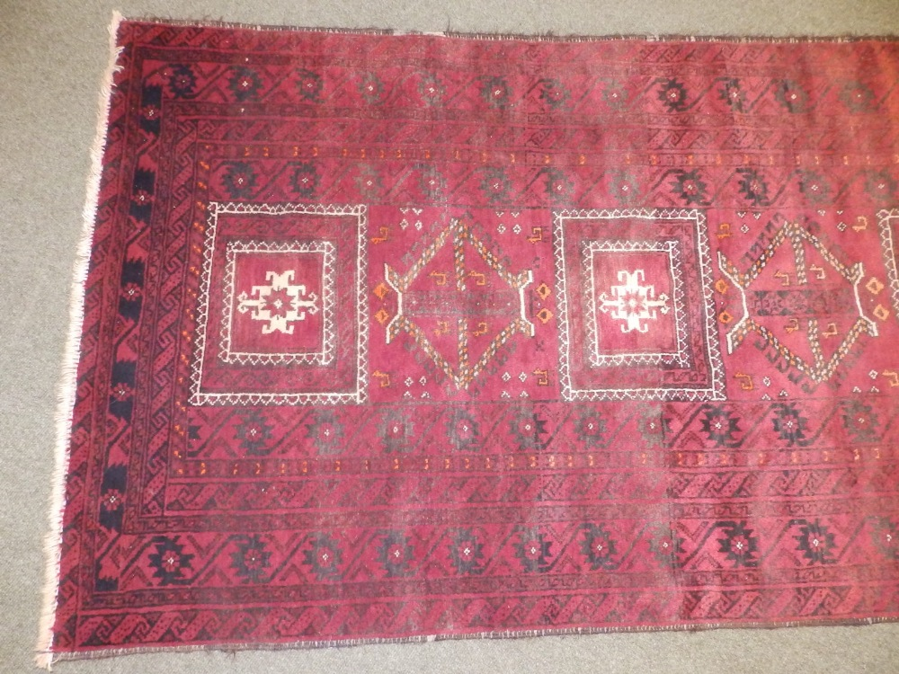 A Baluchi rug, the centre occupied by three rectangles and two octagons with small animal motifs, - Image 3 of 6