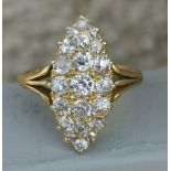 A marquise pave set diamond ring in '18ct' gold. Finger size P.