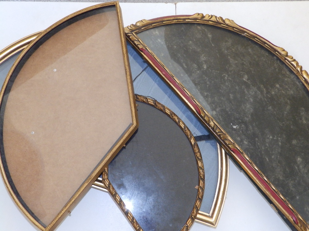 """A gilt metal glazed wall display case for a fan, 20.5"""" across and three gilt wood display cases, the"""