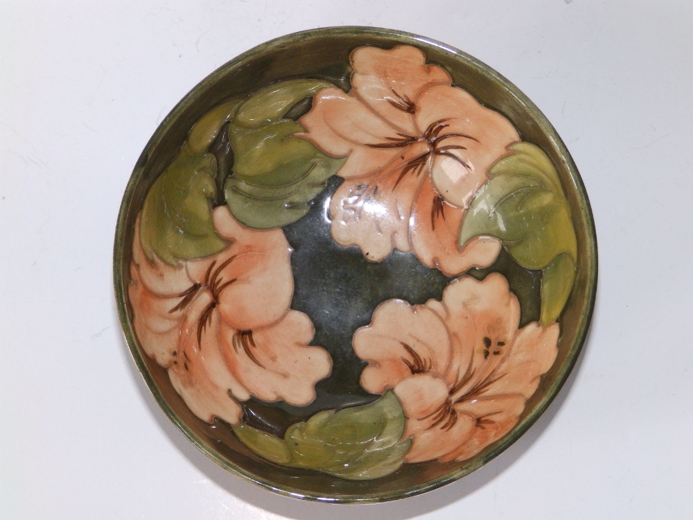 A Walter Moorcroft Coral Hibiscus pattern bowl on green ground, remnants of 'Late Queen Mary' - Image 2 of 3