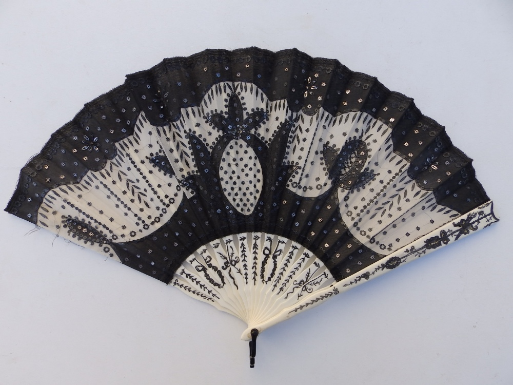 A 19thC ivory fan, the cream silk leaf decorated in black lace with sequins, an openwork monogrammed - Image 2 of 5