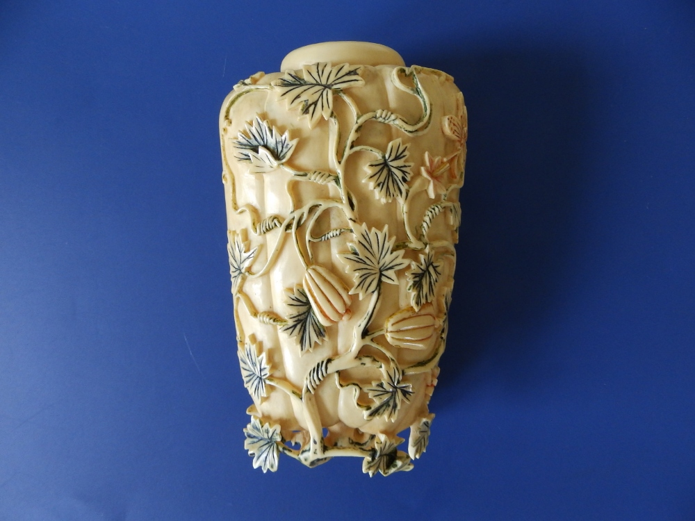 A late 19th/early 20thC Chinese erotic carved ivory study in the form of a flowering gourd, undercut