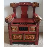 An antique Chinese red & gold lacquered throne chair, having dragon head finials and incised script,