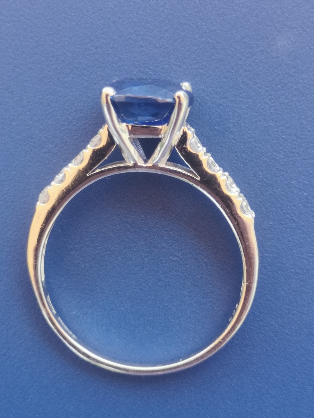 A modern sapphire solitaire ring, in four claw setting with small diamonds to shoulders, 14ct - Image 3 of 3