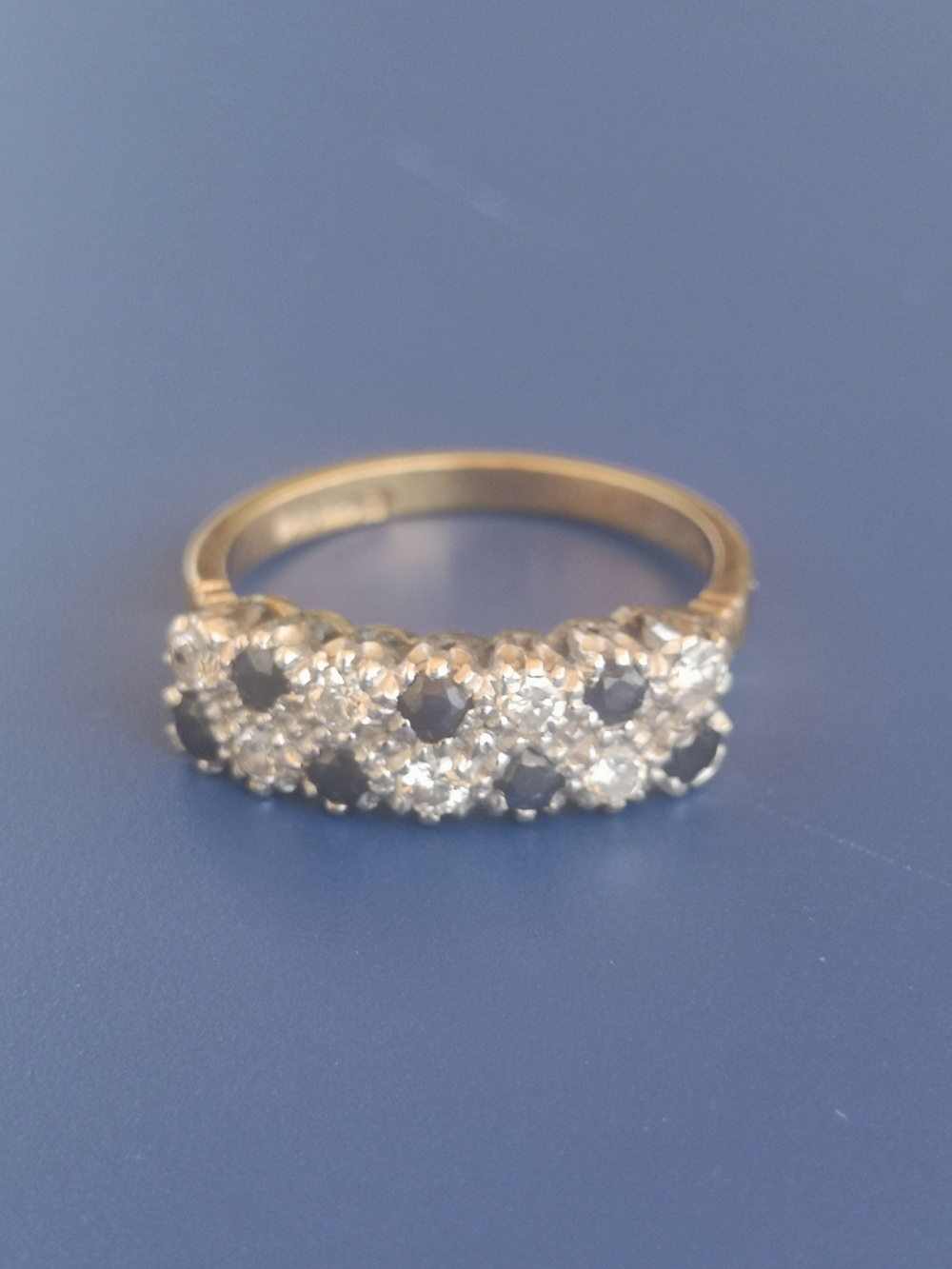 A sapphire & diamond ring set as two rows in 18ct gold. Finger size M/N.