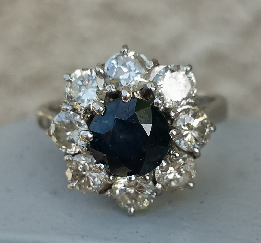 A modern sapphire & diamond 18ct white gold cluster ring - London marks. Finger size L.
