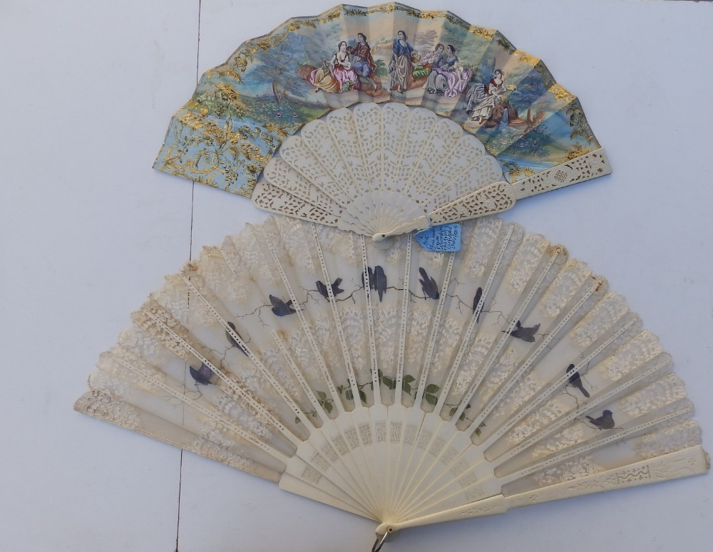 """A large 19thC bone fan, the silk leaf decorated with lace and painted birds, 26"""" across - one"""