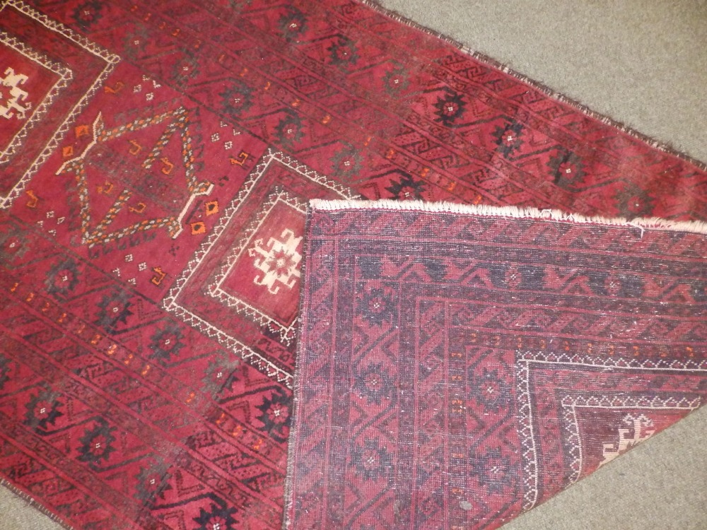 A Baluchi rug, the centre occupied by three rectangles and two octagons with small animal motifs, - Image 4 of 6