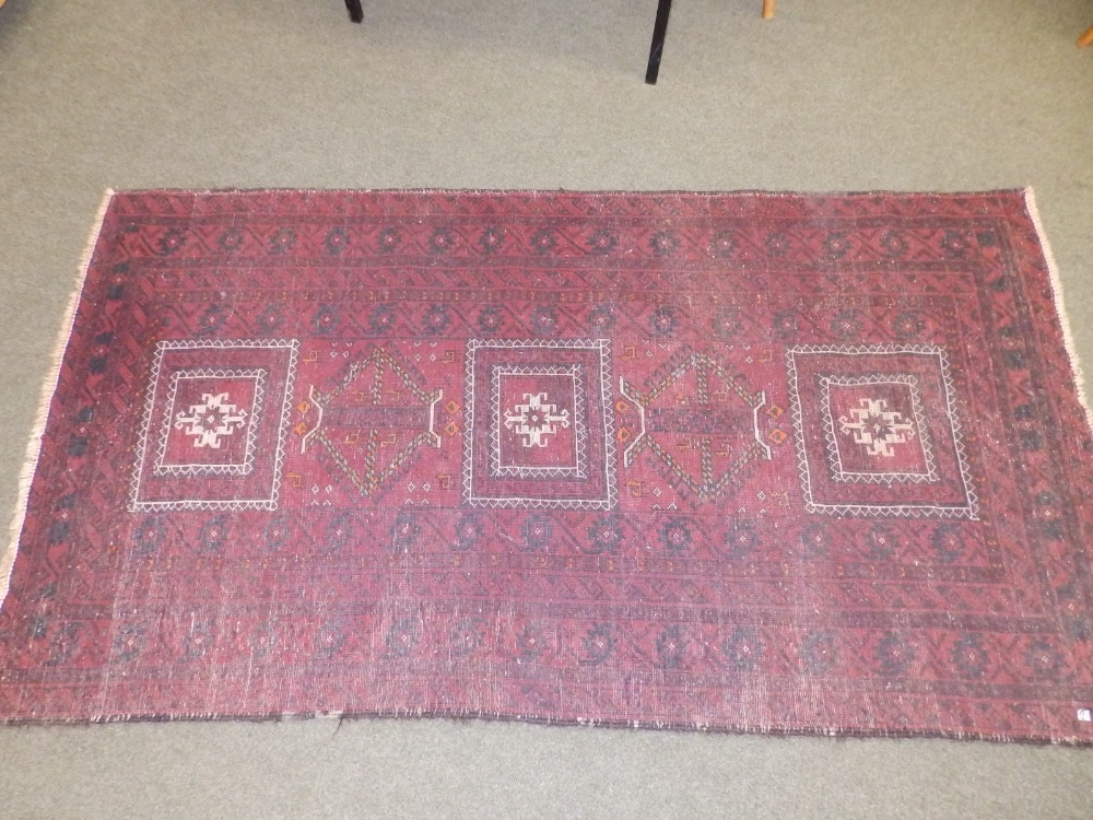 A Baluchi rug, the centre occupied by three rectangles and two octagons with small animal motifs, - Image 5 of 6