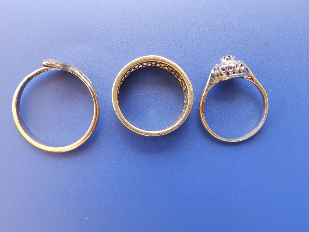 An openwork 18ct gold band ring, a diamond cluster and a 9ct serpent ring. (3) - Image 2 of 2