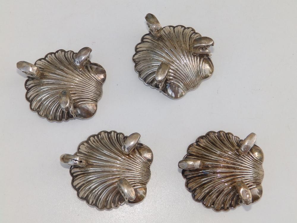 "A set of four silver shell salts, on triple dolphin feet - HA, Birmingham 1862, 2.6"" across. (4) - Image 3 of 3"