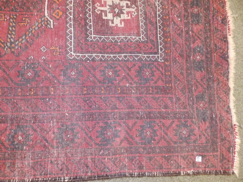 A Baluchi rug, the centre occupied by three rectangles and two octagons with small animal motifs, - Image 6 of 6