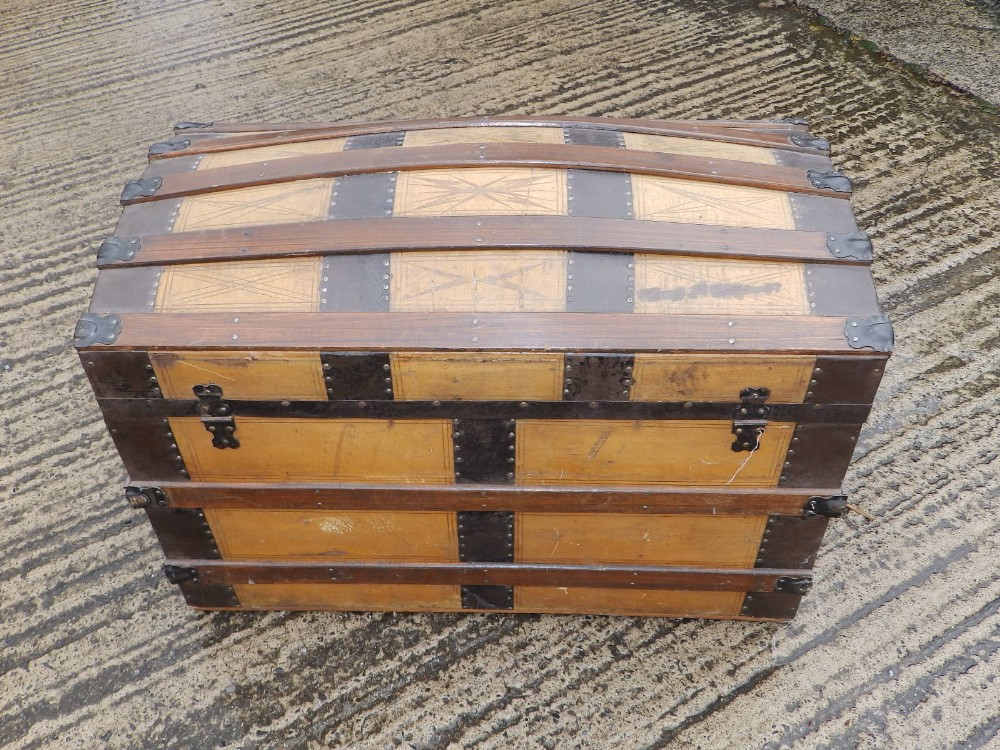 """A domed wooden bound cabin trunk with paper lined interior compartments, 32"""" across. - Image 4 of 10"""