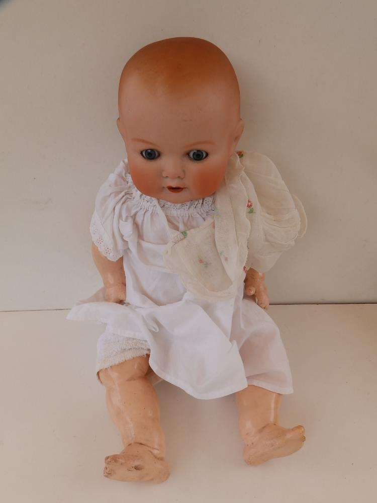 An Armand Marseille bisque head baby doll with blue paperweight eyes, open mouth, composition body - - Image 2 of 3