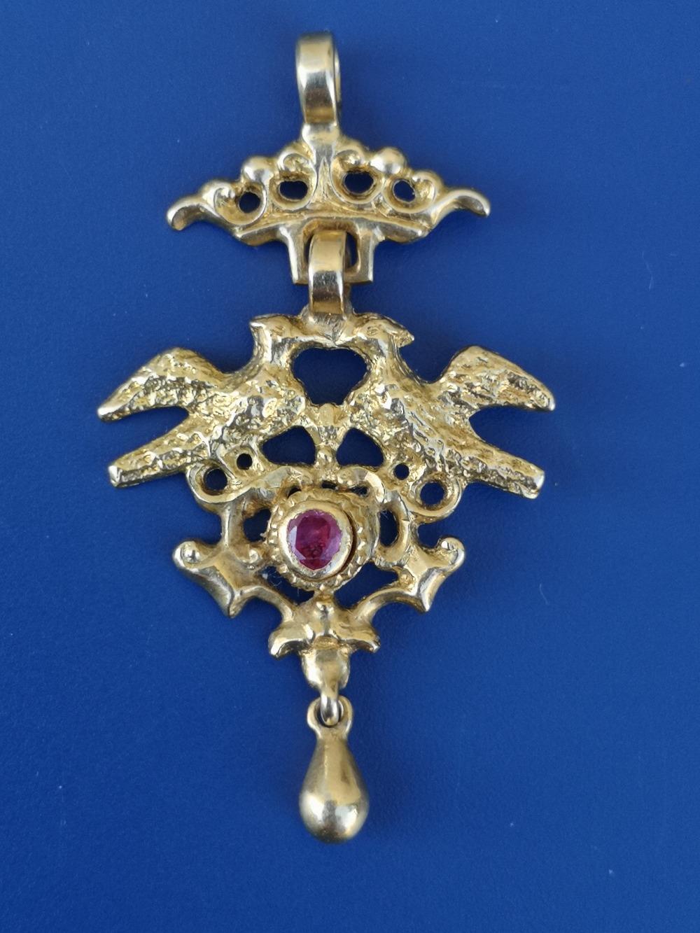 A small 19thC gold pendant in the Renaissance Revival taste, an openwork coronet having an open cast