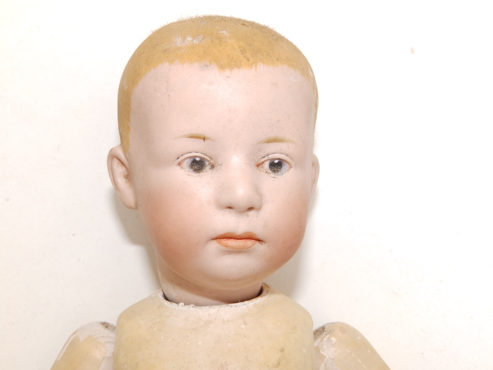 """A German bisque head boy doll with blue painted eyes, painted hair - '6894, 16', 12""""."""