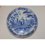 A Victorian blue & white printed earthenware low cakestand, decorated with a maiden collecting water