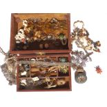 A brown jewellery box containing a micromosaic lidded box & brooch and other costume jewellery.